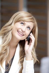 woman with blonde hair on the phone