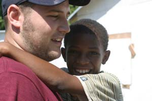 Brett with child from Haiti