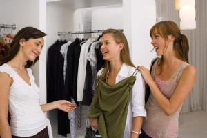 3 women shopping for clothes